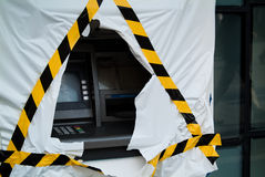 Despair. Close-up photo of a cash machine with protective cover torn Stock Photography