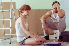 Despair couple renovating house Stock Image