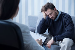 Despair man during therapy Stock Image