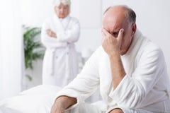 Despair old man in bedroom Royalty Free Stock Photos