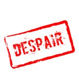 Despair red rubber stamp isolated on white. Stock Images