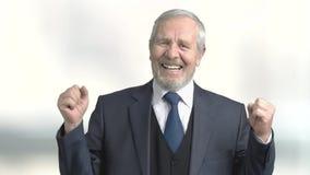 Despair senior businessman, blurred background. Elderly desperate businessman gesturing with hands, slow motion. Stress and depression concept stock video