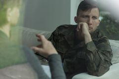 Despair soldier receiving psychological advice Stock Photo