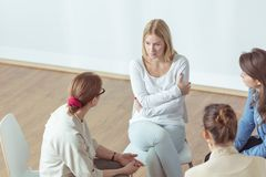 Despair woman talking with coach Royalty Free Stock Images