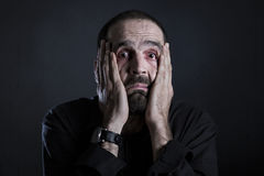 Despaired man looking exhausted and tired. stock images