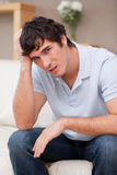 Despaired man sitting on the couch Stock Photo