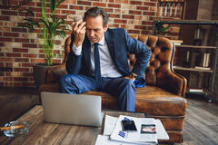 Despaired mature man tensely thinking Royalty Free Stock Photography