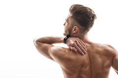 Despaired sportsman feels body pain Stock Photography
