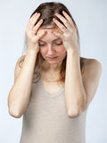 Despaired woman, hands on the forehead Stock Photos