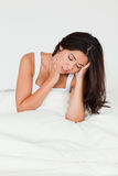 Despairing beautiful woman sitting in bed Stock Photography