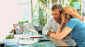 Despairing couple because of their bills stock video footage