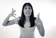 Desperat ung attraktiv kvinna med den ilskna framsidan som ser rasande Mänskliga uttryck och sinnesrörelser royaltyfria foton