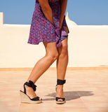 Desperate. Tanned female legs in high heels, crossed Stock Photos
