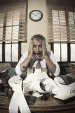 Desperate accountant shouting head in hands in vintage office Stock Photography