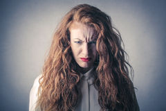 Desperate and angry woman. A desperate and angry woman royalty free stock image