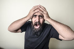 Desperate bearded man  Royalty Free Stock Images