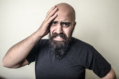 Desperate bearded man  Royalty Free Stock Image