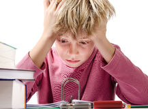 Desperate boy doing is homework Stock Images