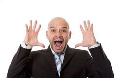 Desperate Brazilian bald businessman screaming and shouting crazy stress with mad face expression in overwork concept stock photo