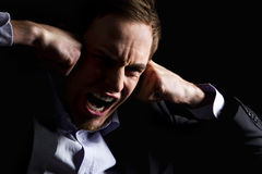 Desperate business executive screaming loudly. Stock Photography