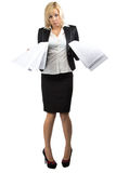 Desperate business lady with a pile of papers Royalty Free Stock Photo