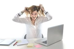 Desperate business woman in stress at work with computer Royalty Free Stock Image