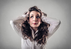Desperate business woman thinking stock photography