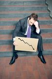 Desperate businessman. Showing negative graph Stock Images