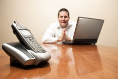 Businessman begs for a phone call. A desperate businessman begs for a phone call Stock Photo
