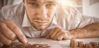 Desperate Businessman Counting His Change Stock Image