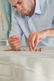 Desperate businessman counting his small change. Desperate young businessman counting his small change Royalty Free Stock Photography