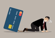 Desperate businessman with credit card burden Royalty Free Stock Images