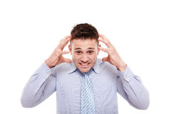 Desperate businessman with hands on head Stock Photo