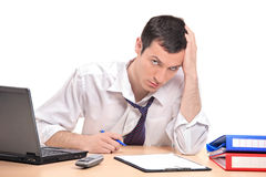 A desperate businessman in his office Stock Photography