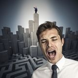 Man going crazy. Desperate businessman and leader on 3d abstract tower, maze background royalty free stock image