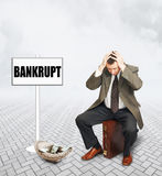Desperate businessman who became bankrupt Royalty Free Stock Images