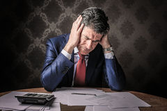 Desperate businessman working Stock Photography