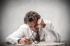 Desperate businessman working Stock Photo