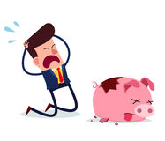 Desperate businessman. Young businessman get desperate because of his piggy bank get broken Royalty Free Stock Photo