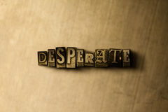 DESPERATE - close-up of grungy vintage typeset word on metal backdrop. Royalty free stock illustration.  Can be used for online banner ads and direct mail Stock Image
