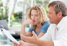 Desperate couple calculating their domestic bills Royalty Free Stock Photo