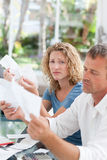 Desperate couple calculating their domestic bills Royalty Free Stock Photos