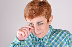 Desperate and depressed crying woman. Wiping the tears Royalty Free Stock Photos