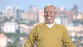 Desperate elderly man, slow motion. Frustrated pensioner screaming on blurred background stock footage