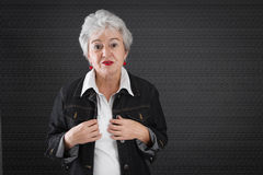 Desperate elderly woman with gray hair Royalty Free Stock Images