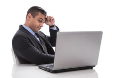 Desperate and exhausted isolated manager at desk - burnout. Stock Image