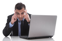Desperate and exhausted isolated manager at desk - burnout. Royalty Free Stock Images