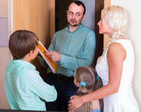 Desperate family and irritated inspector Royalty Free Stock Images