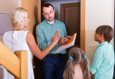 Desperate family and irritated inspector Stock Image