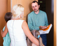 Desperate family and irritated inspector Stock Photos